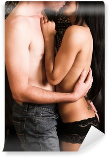 Multi-ethnic couple in passionate embrace and undressing Wall Mural - Vinyl