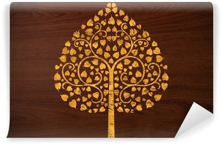 Pattern carve gold tree on wood texture