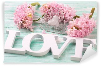 Pink hyacinths flowers, decorative heart and wooden word love o Wall Mural - Vinyl