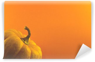 Wall Mural - Vinyl pumpkin on orange background