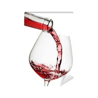 Red wine poured in a glass isolated on white background ...