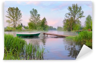 Rural landscape with boat and footbridge on the Narew river. Wall Mural - Vinyl