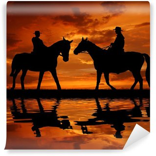 Wall Mural - Vinyl Silhouette cowboys with horses in the sunset