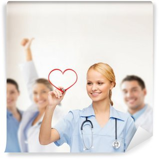 Wall Mural - Vinyl smiling doctor or nurse drawing red heart