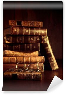 Wall Mural - Vinyl Stack of old books with reading glasses