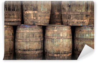 Wall Mural - Vinyl Stacked old whisky barrels