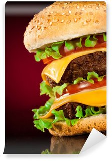 Wall Mural - Vinyl Tasty and appetizing hamburger on a darkly red