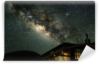 The Milky Way over a mountain house. Wall Mural - Vinyl