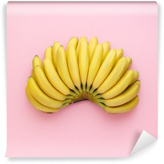 Vinyl Wall Mural Top view of ripe bananas on a bright pink background. Minimal style.
