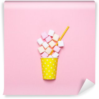 Top view of the pastel marshmallows on a pink background. Minimal style.