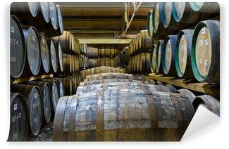 Wall Mural - Vinyl Whisky barrels in a distillery
