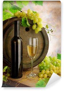White wine, grapevine and old barrel