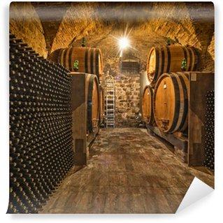 wine cellar with bottles and oak barrels