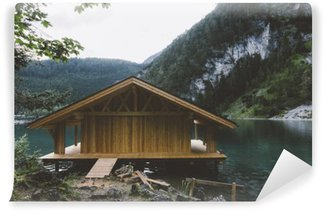 Wood house on lake with mountains and trees Wall Mural - Vinyl