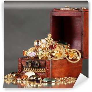 Wall Mural - Vinyl Wooden chest full of gold jewelry on gray background