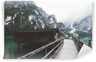 wooden jetty on Braies lake with mountains and trees Wall Mural - Vinyl