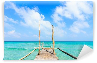 Wooden pier leading to sea on beautiful beach at Nam Du Island