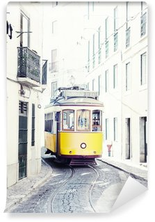 Wall Mural - Vinyl yellow ancient tram on streets of Lisbon, Portugal