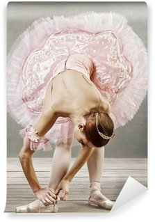 Vinyl Wall Mural Young dancer in beautiful tutu fixing her slippers