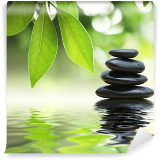 Wall Mural - Vinyl Zen stones pyramid on water surface, green leaves over it