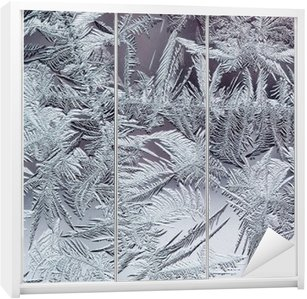 beautiful winter frosty pattern made of brittle transparent crystals on the glass Wardrobe Sticker