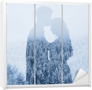 Wardrobe Sticker love in winter, silhouette of couple on forest background, double exposure