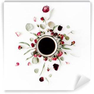 black coffee mug and red rose buds bouquet with eucalyptus on white background. flat lay, top view Washable Wall Mural