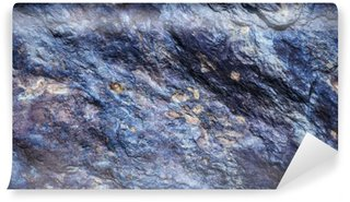 Washable Wall Mural Stone background, rock wall backdrop with rough texture. Abstract, grungy and textured surface of stone material. Nature detail of rocks.