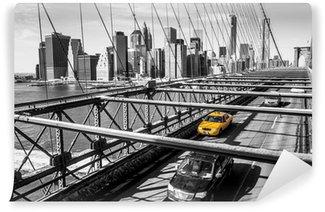 Taxi cab crossing the Brooklyn Bridge in New York Washable Wall Mural