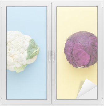 Cauliflower and red cabbage on a bright color background. Seasonal vegetables minimal style. Food in minimal style. Window & Glass Sticker