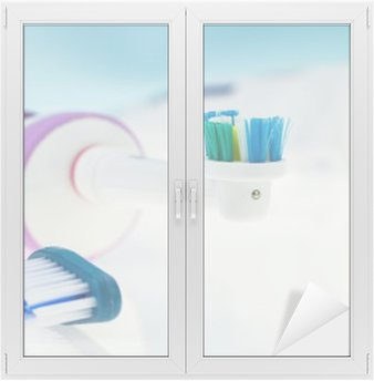 Electric and classic toothbrush on reflective surface and light blue background. Window & Glass Sticker