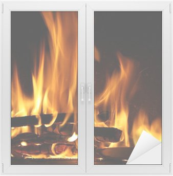 Fire in a fireplace, fire flames on a black background Window & Glass Sticker