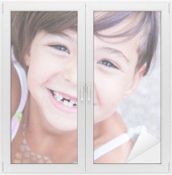 Lovely little girl smilling Window & Glass Sticker