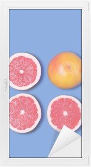 Minimal Design. Fresh Grapefruit on a blue background Window & Glass Sticker