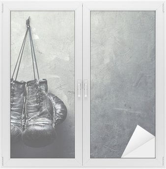 old boxing gloves hang on nail on texture wall Window & Glass Sticker