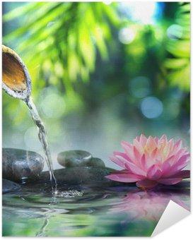 Zelfklevende Poster Zen tuin met zwarte stenen en roze waterlelie