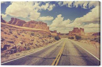Vintage retro stylized scenic desert road, USA.