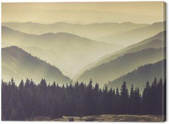 Landscape of misty mountain hills.