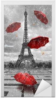 Wieża Eiffla z latającymi parasolami.