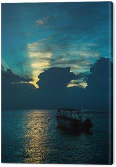Boat in sea at dawn