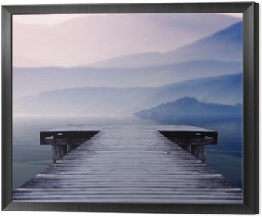 wooden pier on lake site facing a beautiful mountain on a misty winter morning