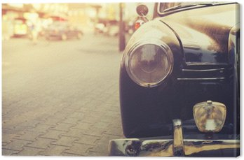 Detail of headlight lamp classic car parked in urban - vintage filter effect style