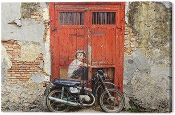 "Graffiti ""Chłopiec na rowerze""."