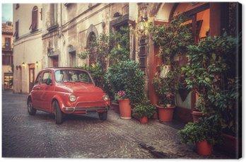 Stare zabytkowe kultowy samochód zaparkowany na ulicy przez restaurację, w