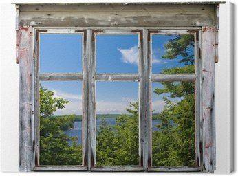 Scenic view seen through an old window frame