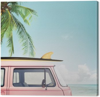 Vintage car parked on the tropical beach (seaside) with a surfboard on the roof