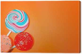Vintage Orange Background With Colored Candy