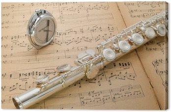 Srebrny flet i kieszeń metronom na starożytnych partytury