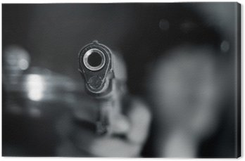 Black and white, woman pointing old gun in hand