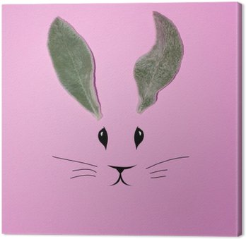 Rabbit ears from the leaves on a pink background